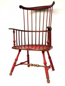 A well worn Comb Back Arm Chair